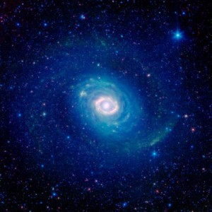This infrared image from NASA's Spitzer Space Telescope shows the double-ringed galaxy Messier 94. Just outside the bright core, a burning ring of star formation glows brightly in the light of warm interstellar dust. Encircling it all is the faint blue glow of starlight forming what was long taken to be an outer ring of stars, but may not be a ring at all.